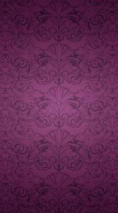 暗めの紫色の背景に植物の文様のような模様が入った待受