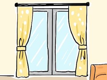 明るい色のカーテンがついた窓