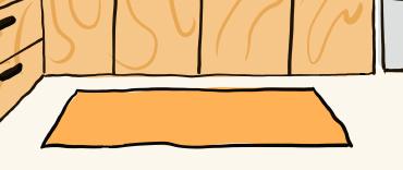 オレンジ色のキッチンマット