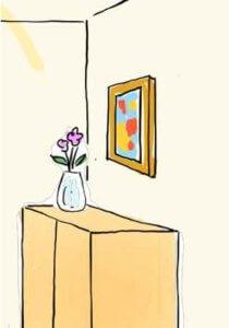 玄関に置かれた絵画と観葉植物